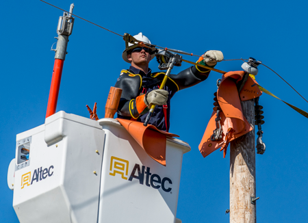 A lineman learns how to maintain power lines while they are energized.