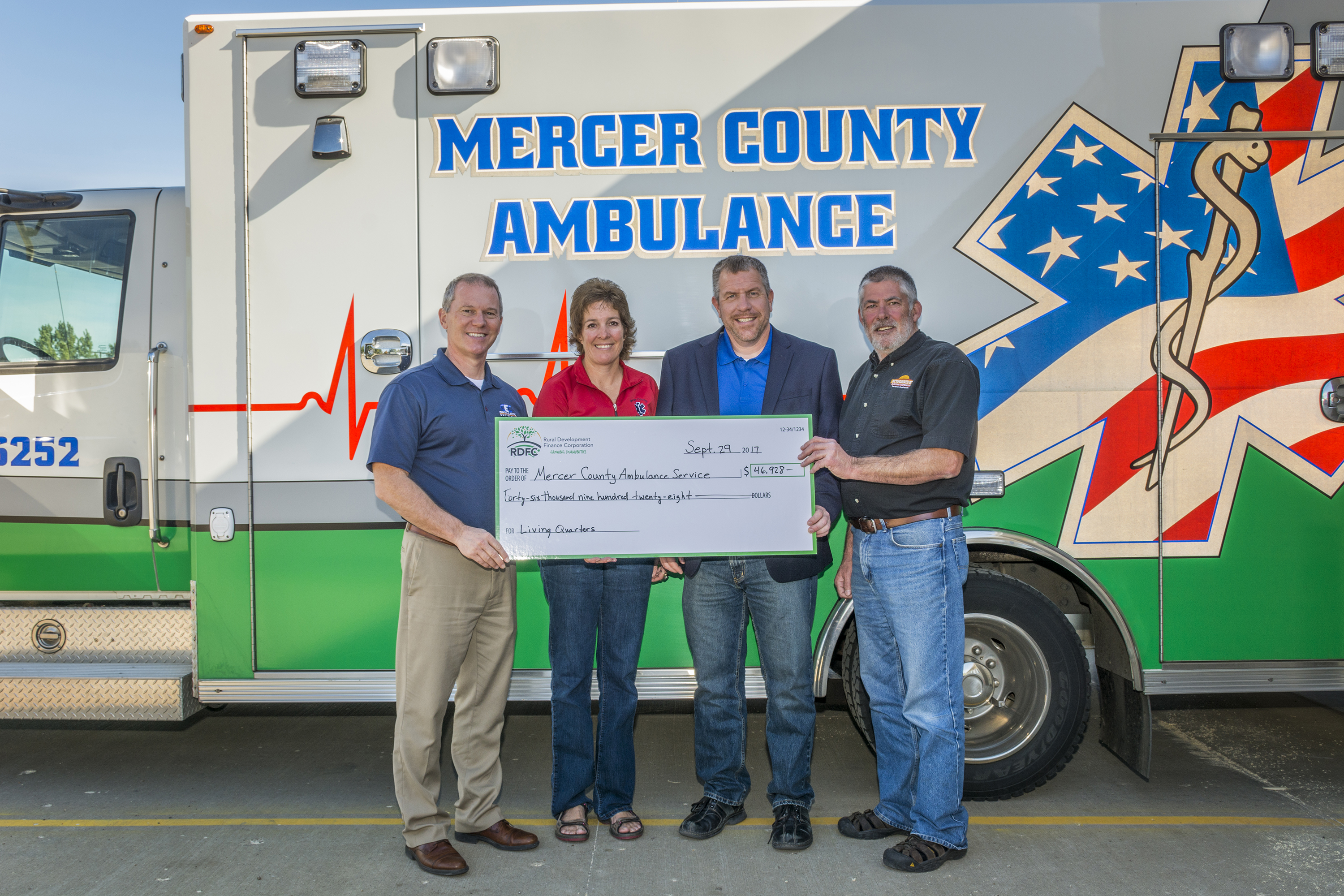 The Mercer County Ambulance crew receives a check from RDFC